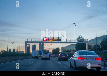 A-1 motorway at dusk. Madrid, Spain. - Stock Photo