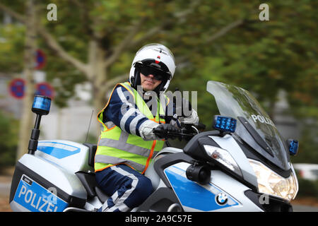 Berlin, Berlin / Germany, September 15, 2018. Berlin police officers on motorcycles securing the Inline Scater race as part of the Berlin Marathon.