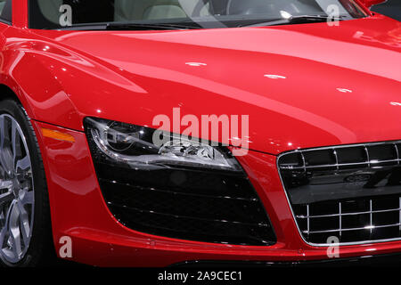Right front fender of a red sports car. - Stock Photo