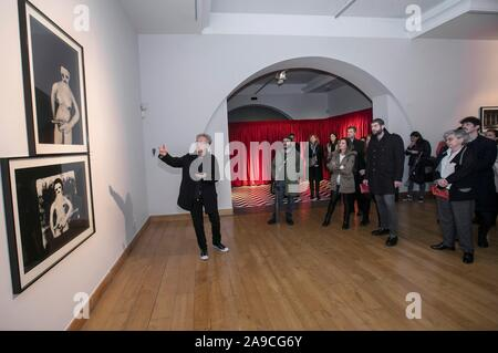 Gijon, Spain. 14th Nov, 2019. Visitors stand in front of artworks by US film director David Lynch as part of the exhibition 'Small Stories' at the Old Institute Cultural Center in Gijon, Asturias, northern Spain, 14 November 2019. 'Small Stories', which is on display as part of the Gijon International Film Festival cultural activities, frames 55 black and white pictures made by Lynch. The exhibition runs from 15 November 2019 to 26 January 2020. Credit: Alberto Morante/EFE/Alamy Live News - Stock Photo