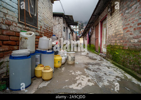 The difficulties of Shimla's residents in accessing clean drinking water is made explicit by these plastic containers outside the home - Stock Photo