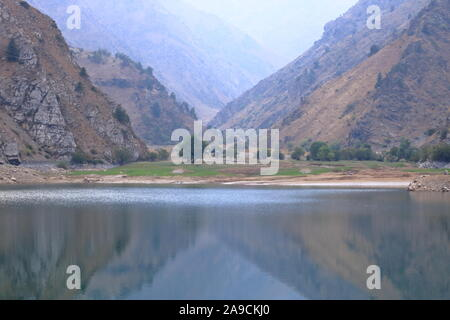 Picturesque Urungach lake in the mountains on early autumn in Uzbekistan