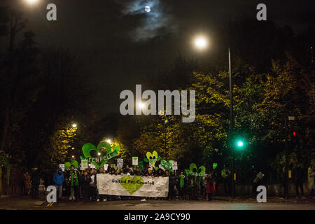 London, UK. 14 November, 2019. Members of the Grenfell community, joined by firefighters and wellwishers, take part in the 29th Grenfell Silent Walk around North Kensington on the monthly anniversary of the Grenfell Tower fire on 14th June 2017 during which 72 people died. It has been a difficult month for the Grenfell community following publication of the first phase of the Grenfell community and highly insensitive comments made by Leader of the House of Commons Jasob Rees-Mogg. Credit: Mark Kerrison/Alamy Live News - Stock Photo