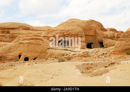 Burial caves in Bab As Siq, Petra, Wadi Musa, Ma'an Governorate, Jordan, Middle East - Stock Photo