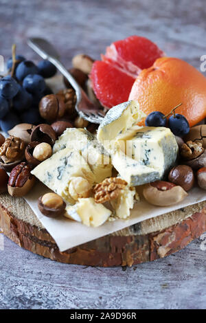 Cheese set with nuts and fruits. Keto diet. Keto snack. Keto Set Selective focus. Macro. - Stock Photo