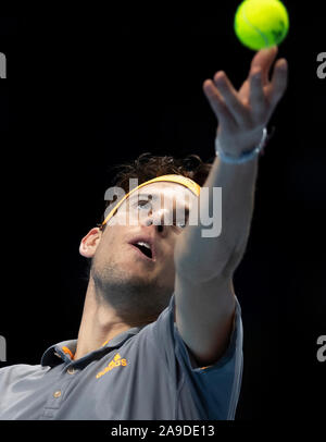 London, UK. 14th Nov, 2019. Dominic Thiem of Austria serves during the singles group match against Matteo Berrettini of Italy at the ATP World Tour Finals 2019 in London, Britain on Nov. 14, 2019. Credit: Han Yan/Xinhua/Alamy Live News - Stock Photo