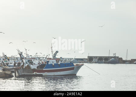 View to fishing boats in the harbour in front of the city of Gallipoli, Apulia, South Italy, Italy, Europe - Stock Photo
