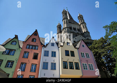 Germany, North Rhine-Westphalia, Cologne, Rhine shore promenade, Old Town houses, restaurants, in the background church Groß Sankt Martin - Stock Photo