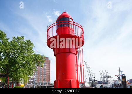 Red lighthouse and senior residence Augustinum in the museum harbour of Övelgönne on the Elbe, Neumühlen, Hamburg harbour, Hamburg, Germany, Europe - Stock Photo
