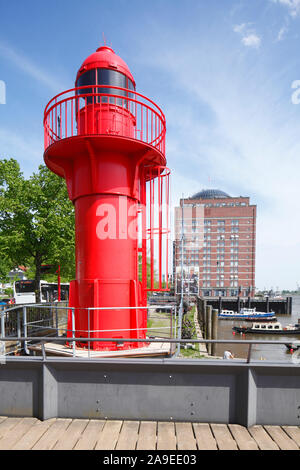 Red lighthouse and senior residence Augustinum in the museum harbour of Övelgönne on the Elbe, new mills, Hamburg harbour, Hamburg, Germany, Europe - Stock Photo