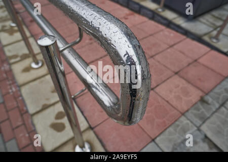 Stainless steel handrails are installed on the walls and steps. - Stock Photo