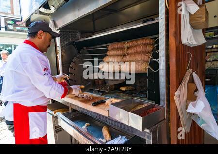 Istanbul, Turkey - August 27, 2013: Turkish kebab chef, cook on Grand Bazaar. Traditional Turkish, arab street food vendor - Stock Photo