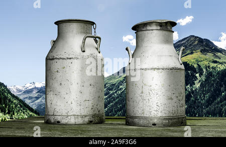 Milk churns in the mountains - Stock Photo