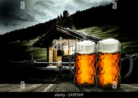 Alpine hut with two measure beer - Stock Photo