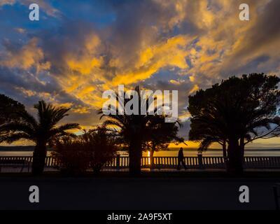 Crikvenica in Croatia evening sunset waterfront seaside promenade scenery - Stock Photo