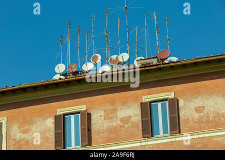 Television aerials and satellite dishes on roof. - Stock Photo