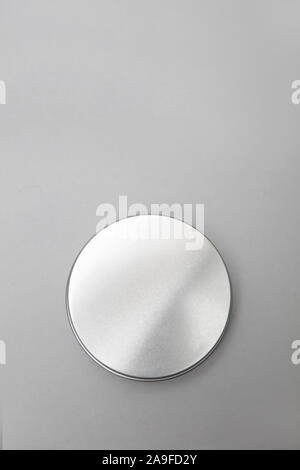 Lip balm in the round metallic tins - Stock Photo