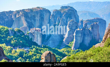 Panoramic view of the rocks of Meteora with The Monastery of Roussanou on the top of the cliff, Greece -  Greek landscape