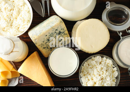 Different dairy products on wooden background, top view - Stock Photo