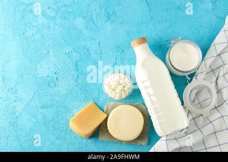 Flat lay composition. Different dairy products on blue background, copy space - Stock Photo