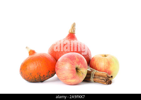 Pumpkins, apples and cinnamon isolated on white background - Stock Photo