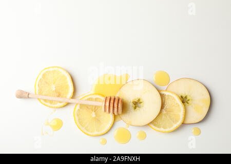 Dipper, honey, apple and lemon slices on white background, top view - Stock Photo
