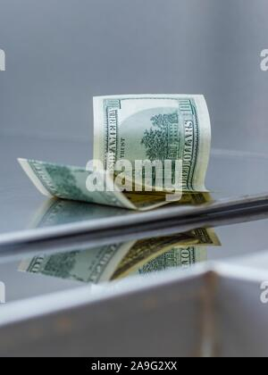 Lost and found money reflection - Stock Photo
