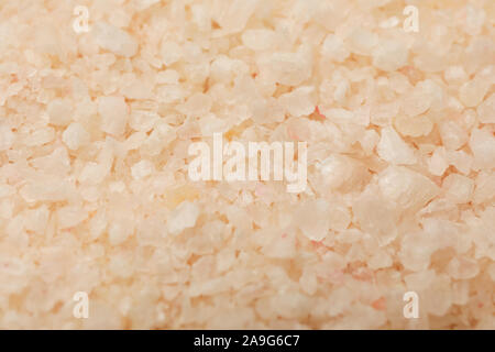 Sea salt for spa textured background, close up. Body care - Stock Photo