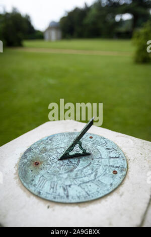 Shallow focus on a sundial in an English parkland setting. - Stock Photo