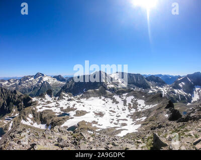 A panoramic view on Schladming Alps, partially still covered with snow. Spring slowly reaching the tallest parts of the mountains. Sharp peaks, slopes - Stock Photo