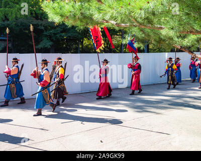 SEOUL, SOUTH KOREA - OCTOBER 30, 2019: guards march in garden of Deoksugung (Deoksu Palace) in Seoul. This complex is one of the Five Grand Palaces bu - Stock Photo