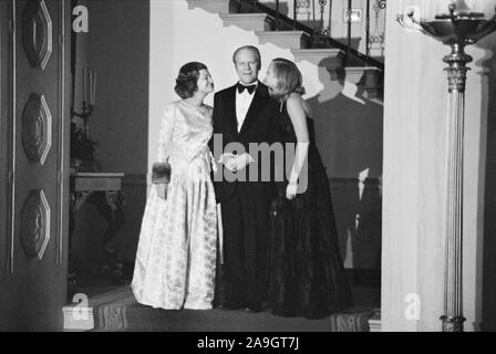 U.S. President Gerald Ford, First Lady Betty Ford, and daughter Susan Ford at a White House Christmas party, Washington, D.C., USA, photograph by Thomas J. O'Halloran,  December 1975