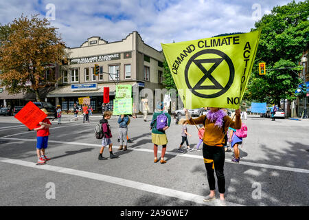 Extinction Rebellion activists occupy and shutdown downtown intersection for four minutes to highlight need for change, Nelson, British Columbia, Cana - Stock Photo