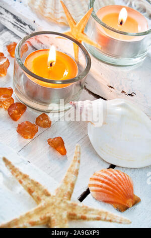 Maritime wellness decoration with mussels and candle - Stock Photo