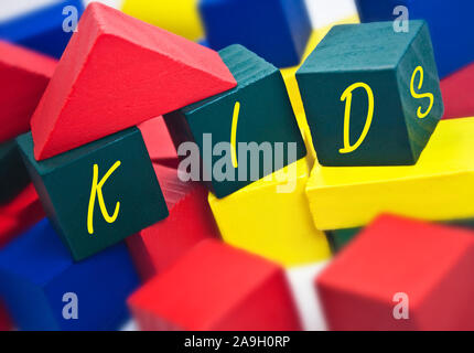 Wooden colorful building bricks - Stock Photo
