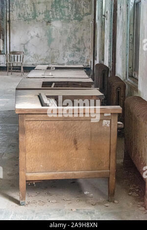 USA, New York, Ellis Island - May 2019: Old furniture abandoned in a derelict building - Stock Photo
