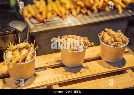 Typical Korean street food on a walking street of Seoul. Spicy fast food simply found at local Korean martket, Soul Korea - Stock Photo