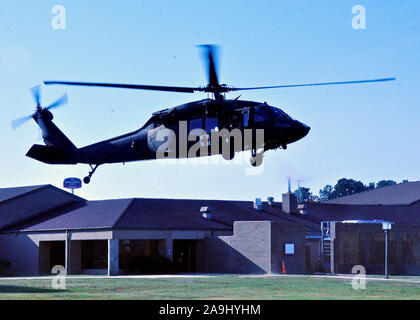 A North Carolina Army National Guard UH-60 Blackhawk helicopter, assigned to Detachment 2, Charlie Company, 1st Battalion, 126th Aviation Regiment (MEDEVAC), prepares to land at the Robeson Community College in Lumberton, North Carolina, Nov. 7, 2019. The UH-60 and crew supported a medical trauma lane training event at the community college. (U.S. Army National Guard photo by Sgt. 1 Class Craig Norton, North Carolina Army National Guard Recruiting & Retention Battalion) - Stock Photo