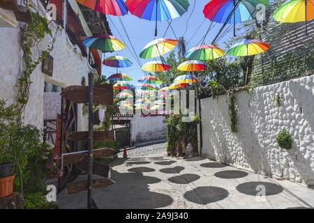 Colorful Detail with Multi Colored Umbrellas over Old Cobblestone Residential Street in Central American Town of Suchitoto, El Salvador