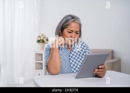 Old woman confident is seriously beautiful - Stock Photo