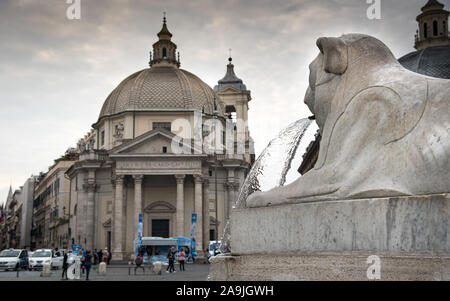 Rome, Italy, October 01 2017: Water through the lion statue head at the  Piazza del Popolo in the Tridente district, Rome Italy. - Stock Photo
