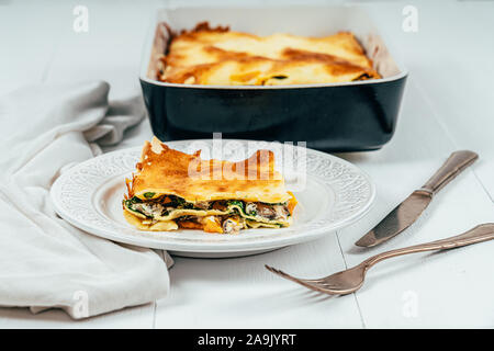 Lasagna Tray Bake With Butternut Squash, Spinach, Ricotta Cheese And Mozzarella - Stock Photo