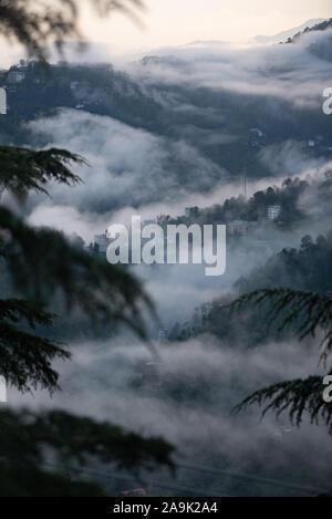 Misty mountains during the monsoon season in the Himalayas. Hills around Shimla, Himachal Pradesh, India - Stock Photo