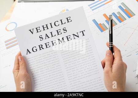 venicle sales agreement concept, documents on the desktop - Stock Photo