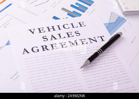 vehicle sales agreement concept, documents on the desktop - Stock Photo