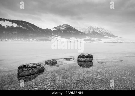 Walchsee winter dream snow fog mountains black and white - Stock Photo