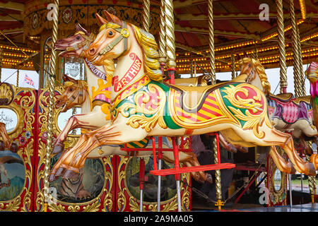 Arthur the galloping horse on the Galloping horses ride at the fair - Stock Photo