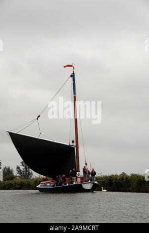 The wherry 'Albion' sailing on a river, Norfolk, England, in inclement weather - Stock Photo