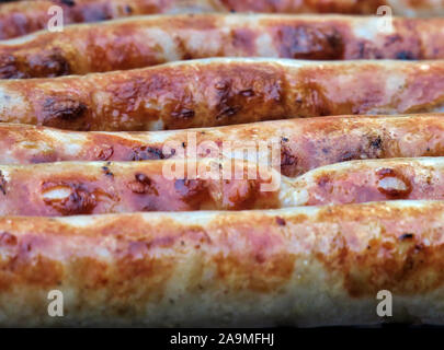 03 October 2019, Thuringia, Oberhof: Thuringian sausages lie on a charcoal grill in a garden. Photo: Soeren Stache/dpa-Zentralbild/ZB - Stock Photo
