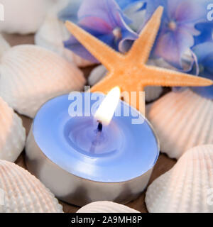 Mussels with candle as background - Stock Photo
